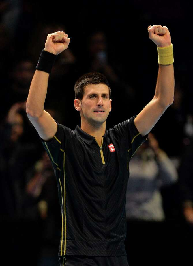 Serbia's Novak Djokovic celebrates winning his Group A singles match against Switzerland's Stanislas Wawrinka on day four of the ATP World Tour Finals tennis tournament in London on November 12, 2014. Djokovic won 6-3, 6-0. AFP PHOTO/GLYN KIRKGLYN KIRK/AFP/Getty Images Photo: GLYN KIRK, Stringer / AFP