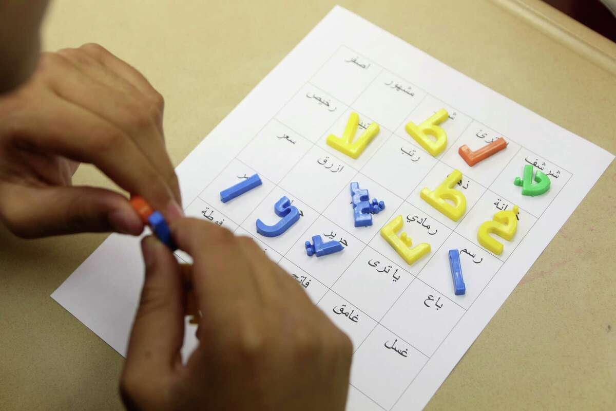 Students play word bingo in the Level 3 Arabic Class at Bellaire High School. HISD is opening a new Arabic-immersion school.
