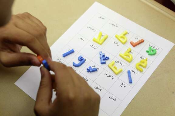 Students play word bingo in the Level 3 Arabic Class at Bellaire High School on Tuesday, Nov. 11, 2014, in Houston.  HISD plans for a new Arabic-immersion school.