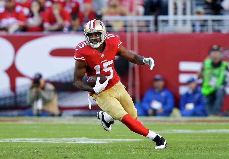 With the 49ers, Michael Crabtree had 68 catches last season, averaging a career-low 10.3 yards. Photo: Ezra Shaw / Getty Images / 2014 Getty Images