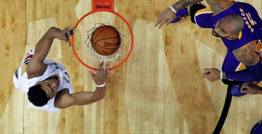 New Orleans Pelicans forward Anthony Davis, left, dunks against Los Angeles Lakers forward Carlos Boozer (5) during the first half of an NBA basketball game in New Orleans, Wednesday, Nov. 12, 2014. (AP Photo/Gerald Herbert) Photo: Gerald Herbert / Associated Press / AP