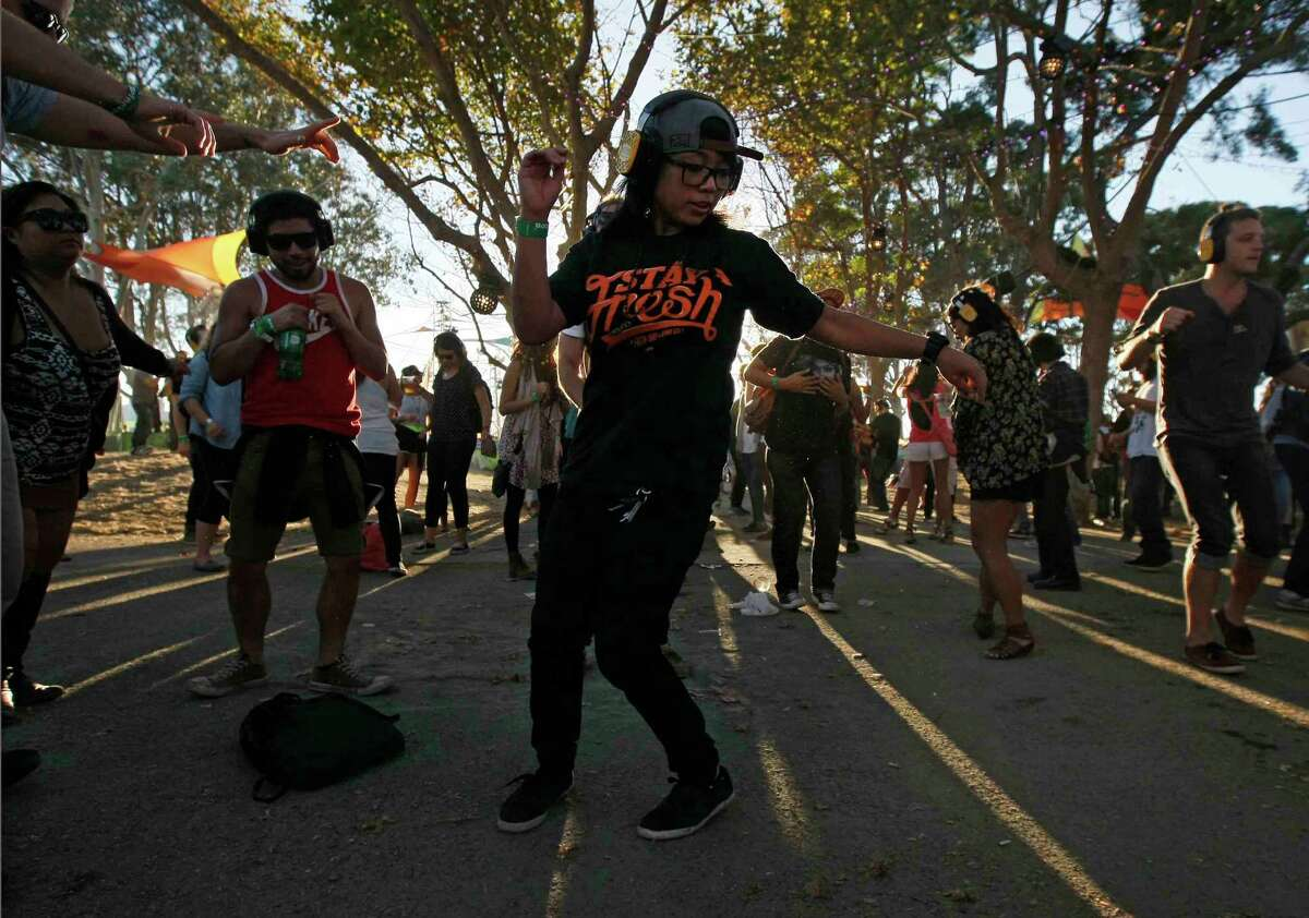 Renee Aquino of San Francisco dances at a Silent Frisco party at the Treasure Island Music Festival in October.