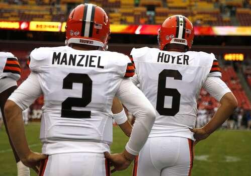 Johnny Manziel, left, has spent his rookie season backing up Brian Hoyer. Photo: Evan Vucci, Associated Press