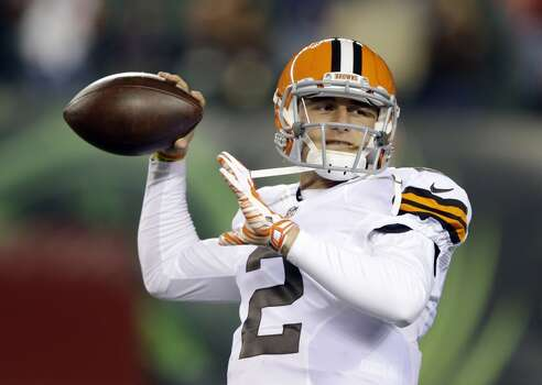 Cleveland Browns quarterback Johnny Manziel warms up before the start of an NFL football game against the Cincinnati Bengals Thursday, Nov. 6, 2014, in Cincinnati. (AP Photo/Michael Conroy) Photo: Michael Conroy, Associated Press