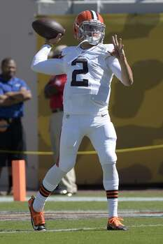 Cleveland Browns quarterback Johnny Manziel (2) throws during warmups before an NFL football game against the Jacksonville Jaguars in Jacksonville, Fla., Sunday, Oct. 19, 2014.(AP Photo/Phelan M. Ebenhack) Photo: Phelan M. Ebenhack, Associated Press
