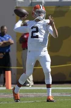 Cleveland Browns quarterback Johnny Manziel (2) throws during warmups before an NFL football game against the Jacksonville Jaguars in Jacksonville, Fla., Sunday, Oct. 19, 2014.(AP Photo/Phelan M. Ebenhack) Photo: Phelan M. Ebenhack, Associated Press
