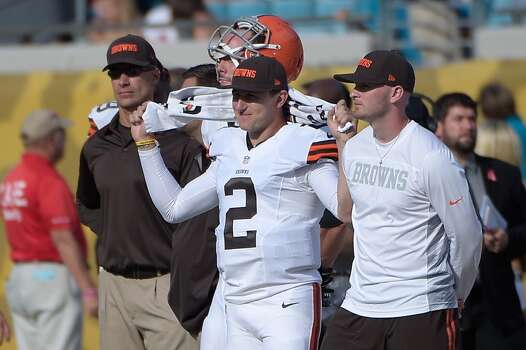 Cleveland Browns quarterback Johnny Manziel (2) watches from the sideline during the second half of an NFL football game against the Jacksonville Jaguars in Jacksonville, Fla., Sunday, Oct. 19, 2014.(AP Photo/Phelan M. Ebenhack) Photo: Phelan M. Ebenhack, Associated Press