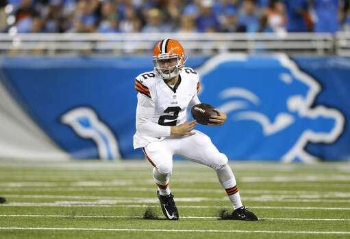 Cleveland Browns quarterback Johnny Manziel (2) scrambles against the Detroit Lions in the first half of a preseason NFL football game at Ford Field in Detroit, Saturday, Aug. 9, 2014.  (AP Photo/Rick Osentoski) Photo: Rick Osentoski, Associated Press