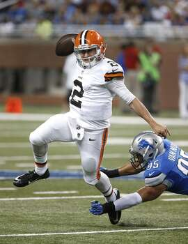 Cleveland Browns quarterback Johnny Manziel (2) escapes a diving Detroit Lions outside linebacker Kyle Van Noy (95) in the second half of a preseason NFL football game at Ford Field in Detroit, Saturday, Aug. 9, 2014.  (AP Photo/Duane Burleson) Photo: Duane Burleson, Associated Press