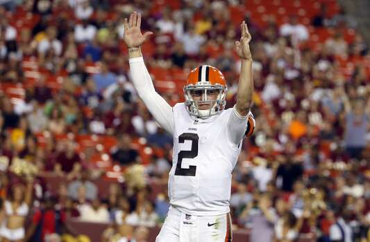 Cleveland Browns quarterback Johnny Manziel (2) celebrates running back Dion Lewis (28) scoring a touchdown on a pass, during the second half of an NFL preseason football game against the Washington Redskins Monday, Aug. 18, 2014, in Landover, Md. (AP Photo/Evan Vucci) Photo: Evan Vucci, Associated Press