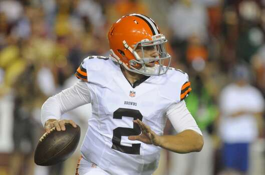Cleveland Browns quarterback Johnny Manziel (2) looks to pass during the first half of an NFL preseason football game against the Washington Redskins Monday, Aug. 18, 2014, in Landover, Md. (AP Photo/Richard Lipski) Photo: Richard Lipski, Associated Press