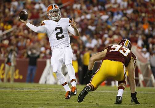 Cleveland Browns quarterback Johnny Manziel (2) passes in front of Washington Redskins linebacker Trent Murphy (93) during the second half of an NFL preseason football game Monday, Aug. 18, 2014, in Landover, Md. (AP Photo/Evan Vucci) Photo: Evan Vucci, Associated Press