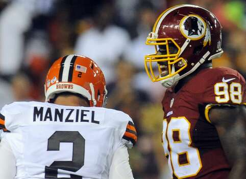 Washington Redskins outside linebacker Brian Orakpo (98) reacts after Cleveland Browns quarterback Johnny Manziel (2) was sacked during the first half of an NFL preseason football game Monday, Aug. 18, 2014, in Landover, Md. (AP Photo/Richard Lipski) Photo: Richard Lipski, Associated Press