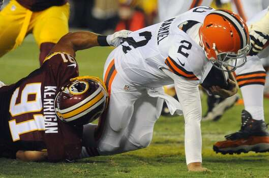 Washington Redskins outside linebacker Ryan Kerrigan (91) sacks Cleveland Browns quarterback Johnny Manziel (2) during the first half of an NFL preseason football game Monday, Aug. 18, 2014, in Landover, Md. (AP Photo/Richard Lipski) Photo: Richard Lipski, Associated Press