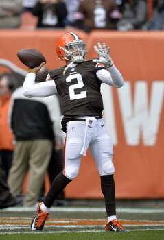 Cleveland Browns quarterback Johnny Manziel warms up before an NFL football game against the Tampa Bay Buccaneers Sunday, Nov. 2, 2014, in Cleveland. (AP Photo/David Richard) Photo: David Richard, Associated Press