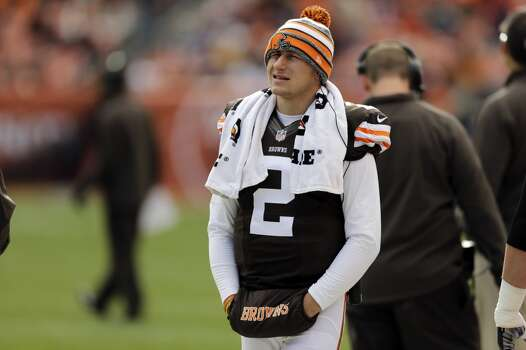 Cleveland Browns quarterback Johnny Manziel watches from the sidelines in the fourth quarter of a 22-17 win over the Tampa Bay Buccaneers in an NFL football game Sunday, Nov. 2, 2014, in Cleveland. (AP Photo/Tony Dejak) Photo: Tony Dejak, Associated Press