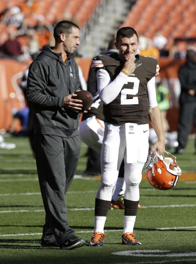 Cleveland Browns quarterback Johnny Manziel (2) talks with offensive coordinator Kyle Shanahan before an NFL football game against the Oakland Raiders Sunday, Oct. 26, 2014, in Cleveland. (AP Photo/Tony Dejak) Photo: Tony Dejak, Associated Press