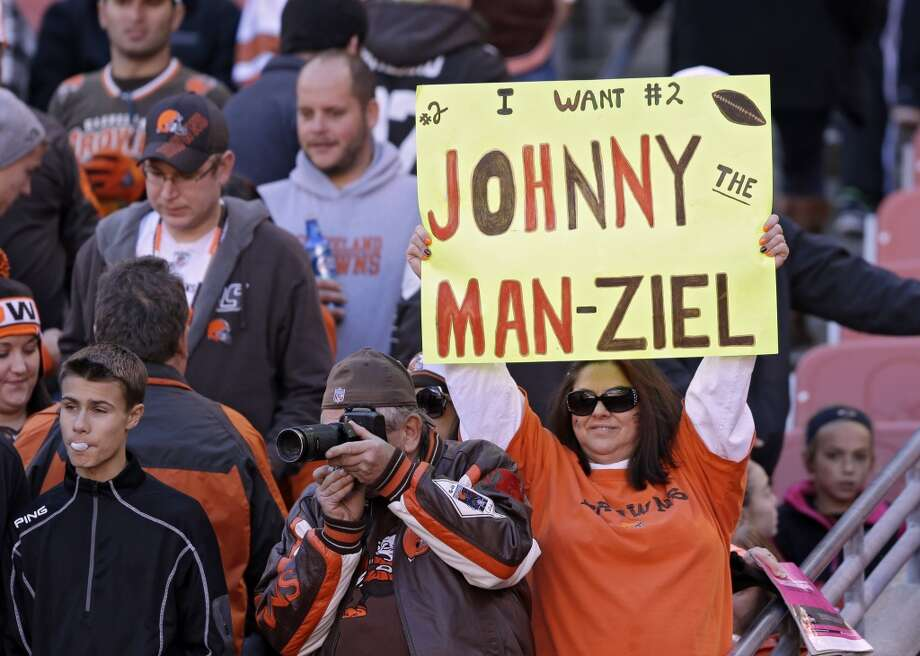 A fan holds a sign for Cleveland Browns quarterback Johnny Manziel before an NFL football game against the Oakland Raiders Sunday, Oct. 26, 2014, in Cleveland. (AP Photo/Tony Dejak) Photo: Tony Dejak, Associated Press