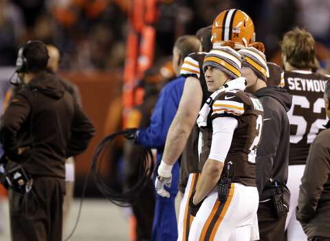 Cleveland Browns quarterback Johnny Manziel watches from the sidelines in the fourth quarter of an NFL football game against the Oakland Raiders Sunday, Oct. 26, 2014, in Cleveland. (AP Photo/Tony Dejak) Photo: Tony Dejak, Associated Press