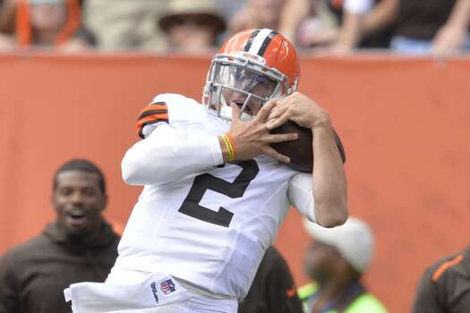 Cleveland Browns quarterback Johnny Manziel (2) catches a pass on a trick play in the second quarter of an NFL football game against the Baltimore Ravens Sunday, Sept. 21, 2014, in Cleveland. The play was called back on a Browns penalty. (AP Photo/David Richard) Photo: David Richard, Associated Press