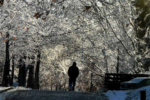 STEVE JACOBS / TIMES UNION , 12/13/08, Schenectady,NY--  AFTER THE STORM --   A man walks under a tunnel of ice-covered tree on the Union College Campus a day after an ice storm hit the Schenectady area, Saturday, december 13,2008 ( FOR STORY) 2 of 2 photos Photo: STEVE JACOBS, TIMES UNION / 00001665C