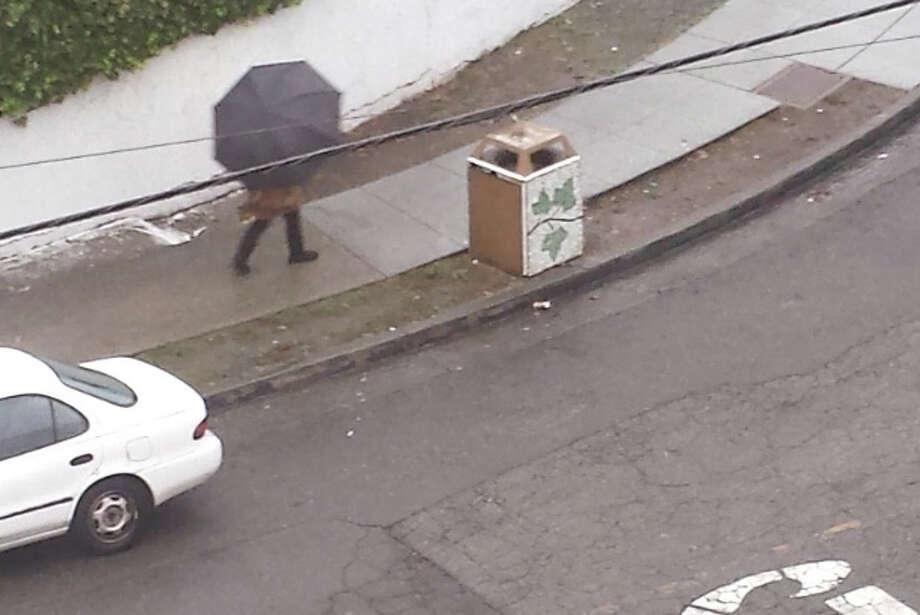 A pedestrian walks through a light rainfall on Thursday morning. Photo: SF Gate / Douglas Zimmerman