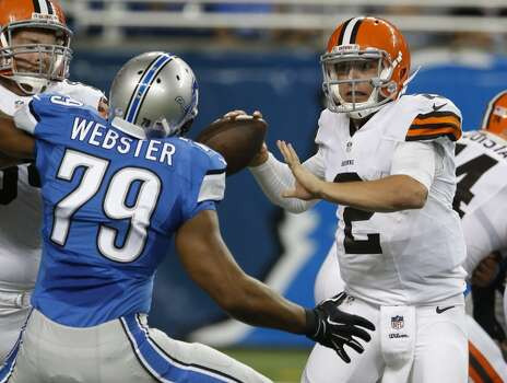 Cleveland Browns quarterback Johnny Manziel (2) is pressured by Detroit Lions defensive end Larry Webster (79) in the second half of a preseason NFL football game at Ford Field in Detroit, Saturday, Aug. 9, 2014.  (AP Photo/Duane Burleson) Photo: Duane Burleson, Associated Press