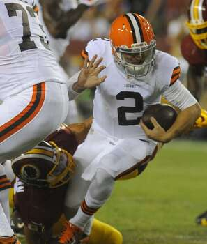 Cleveland Browns quarterback Johnny Manziel (2) is sacked by Washington Redskins outside linebacker Ryan Kerrigan (91) during the first half of an NFL preseason football game Monday, Aug. 18, 2014, in Landover, Md. (AP Photo/Richard Lipski) Photo: Richard Lipski, Associated Press