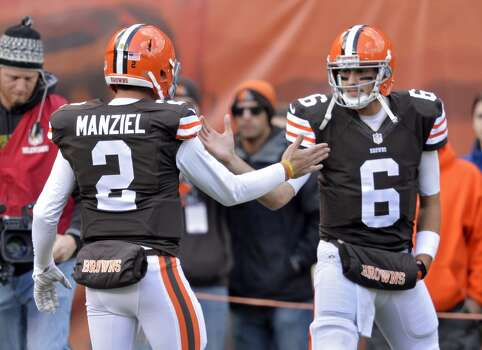 Cleveland Browns quarterback Brian Hoyer (6) greets Johnny Manziel (2) on the sidelines before an NFL football game against the Tampa Bay Buccaneers Sunday, Nov. 2, 2014, in Cleveland. (AP Photo/David Richard) Photo: David Richard, Associated Press