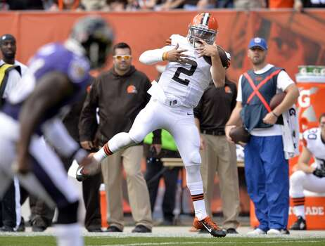 FILE - In this Sept. 21, 2014, file photo, Cleveland Browns quarterback Johnny Manziel (2) makes a catch on a trick play in the second quarter of an NFL football game against the Baltimore Ravens in Cleveland. The play was called back on a Browns penalty. After handing off the ball on tje play, Manziel wandered over toward the Browns' sideline, pretending to argue with offensive coordinator Kyle Shanahan while apparently on his way out of the game. But Manziel never left the field, and he raced along the sideline to haul in a pass from Brian Hoyer for what would have been a 39-yard gain. (AP Photo/David Richard, File) Photo: David Richard, Associated Press