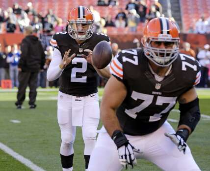 Cleveland Browns quarterback Johnny Manziel takes a snap during warm ups before an NFL football game between the Oakland Raiders and Cleveland Browns Sunday, Oct. 26, 2014, in Cleveland. (AP Photo/Tony Dejak) Photo: Tony Dejak, Associated Press