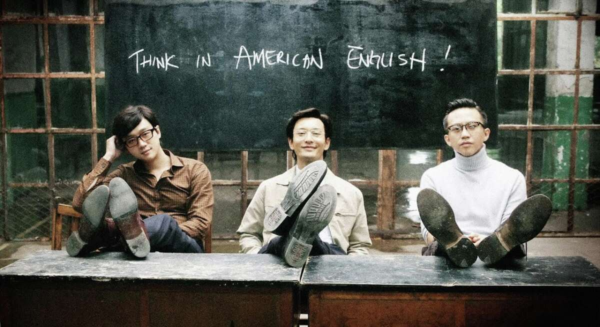 """Wang (Tong Daiwei, left), and Cheng (Huang Xiaming) start a language school for potential emigres, while Meng (Deng Chao) heads for the USA himself in """"American Dreams in China."""""""