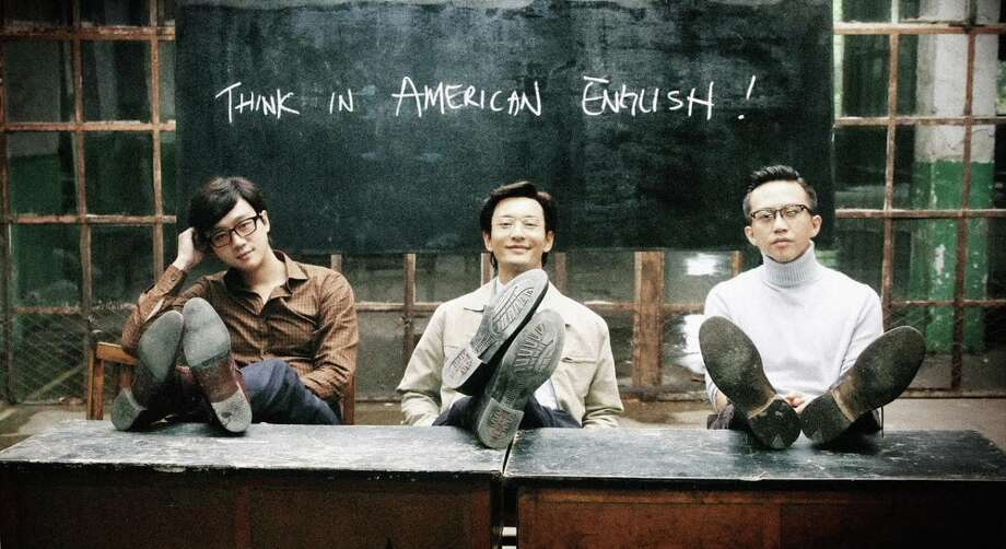 """Wang (Tong Daiwei, left), and Cheng (Huang Xiaming) start a language school for potential emigres, while Meng (Deng Chao) heads for the USA himself in """"American Dreams in China."""" Photo: We Pictures / We Pictures"""