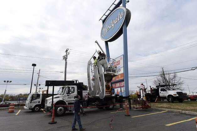 "The Westgate Shopping Center sign in Albany is coming down for renovations. The ""W"" is the first letter removed on Thursday, Nov. 13, 2014. The rest coming down Saturday. (Skip Dickstein/Times Union)"