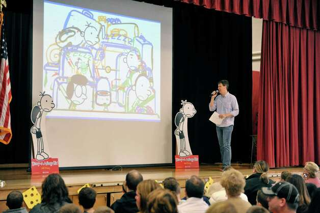 Jeff Kinney, author/illustrator of the Diary of a Wimpy Kid books, talks about his journey to becoming an author during a  book tour stop at Skano Elementary School Thursday, Nov. 13, 2014, in Clifton Park, N.Y.  On the screen is an early sketch from his latest book. (Paul Buckowski / Times Union) Photo: Paul Buckowski / 00029458A