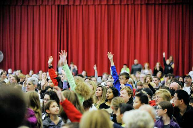 Children raise their hand to ask a question of  Jeff Kinney, author/illustrator of the Diary of a Wimpy Kid books, Thursday, Nov. 13, 2014, during a  book tour stop at Skano Elementary School in Clifton Park, N.Y.  (Paul Buckowski / Times Union) Photo: Paul Buckowski / 00029458A