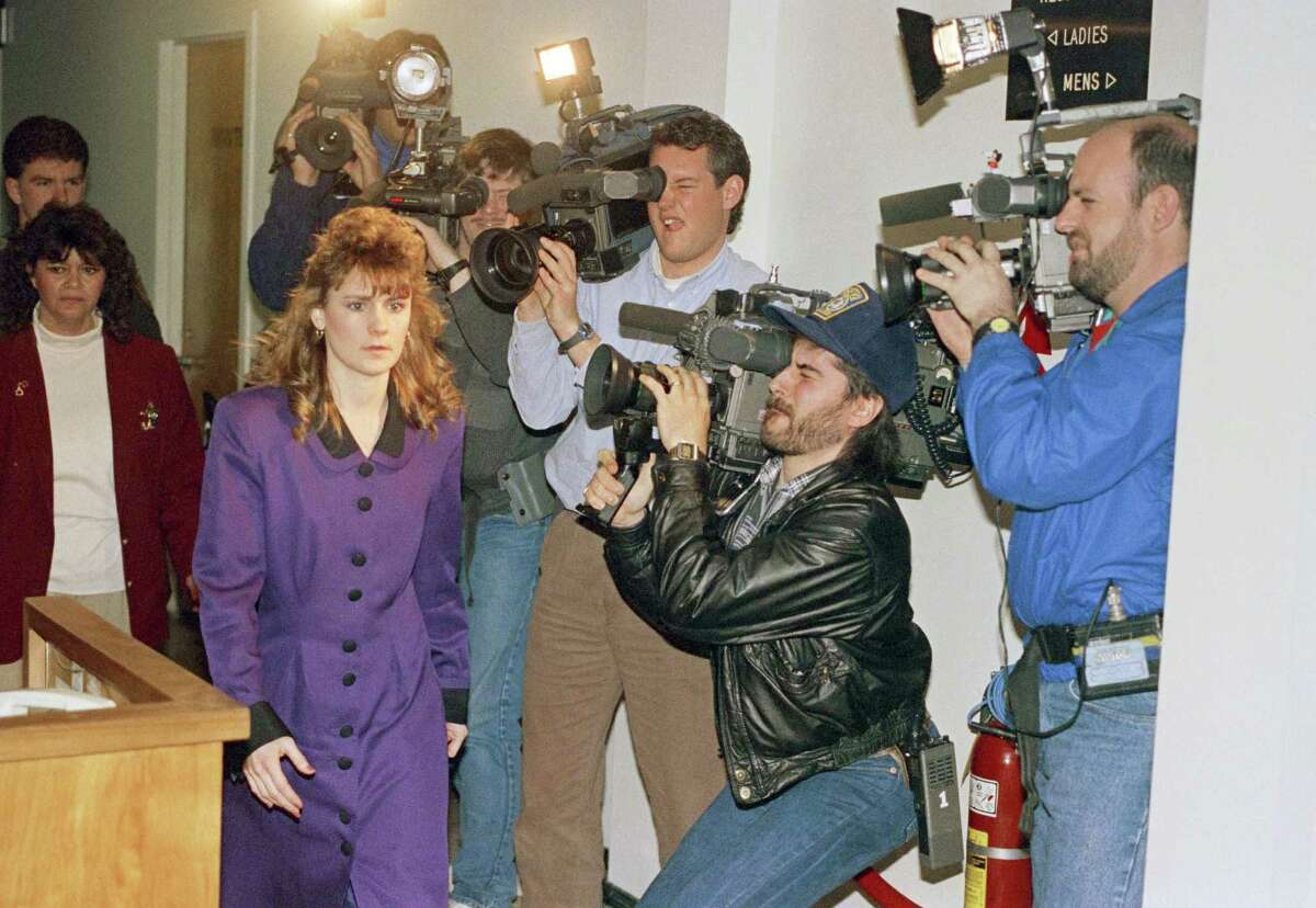 Pamela Smart walks past cameras at Rockingham County Superior Court in Exeter, New Hampshire on Thursday, March 21, 1991, as she waits for a verdict in her murder conspiracy trial. The jury was sequestered on Thursday, after deliberating for 9 hours without reaching a verdict. (AP Photo/Jon Pierre Lasseigne)