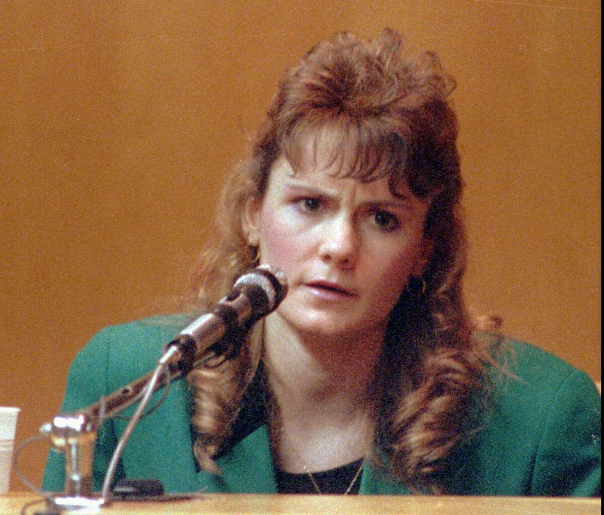 Pamela Smart, convicted for conspiracy to commit murder in the death of her husband and sentenced to life without the possibility of parole, is seen on the witness stand in this 1991 photo from Rockingham County Superior Court in Exeter, N.H. (AP Photo/Jim Cole)