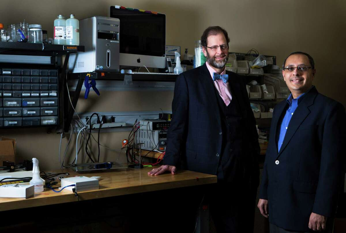 Leo Linbeck III, left, founder and chairman of Fannin Innovation Studio and managing partner Atul Varadhachary, right, develop medical technologies along with their portfolio companies like Procyrion. Wednesday, Nov. 12, 2014, in Houston. ( Marie D. De Jesus / Houston Chronicle )