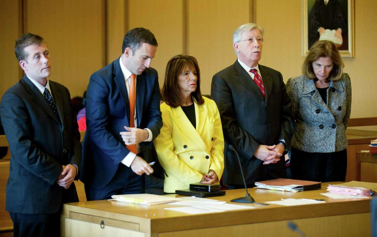 Stamford High School Principal Donna Valentine, left, and Assistant Principal Roth Nordin, right, appear in State Superior Court in Stamford, Conn., on Thursday, November 13, 2014. With them are, from left, victim's attorney Devin Janosov, Valentine's attorney Mark Sherman, and Nordin's attorney Fred O'Brien.