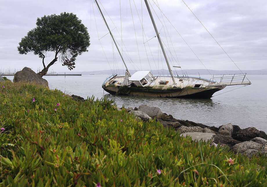 An abandoned 35-foot sailboat remains stuck in the muddy bay shore at Oyster Point in South San Francisco, Calif. on Wednesday, Nov. 12, 2014. Photo: Paul Chinn, The Chronicle