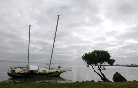 Ditched sailboat at Oyster Point has become a rotting