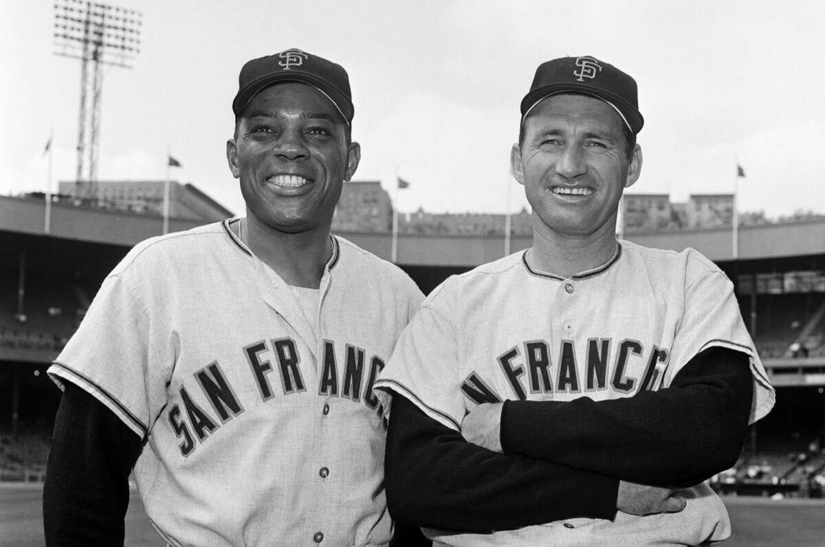 San Francisco Giants' Willie Mays, left, Alvin Dark, right, at the Polo Grounds in New York, 1963.
