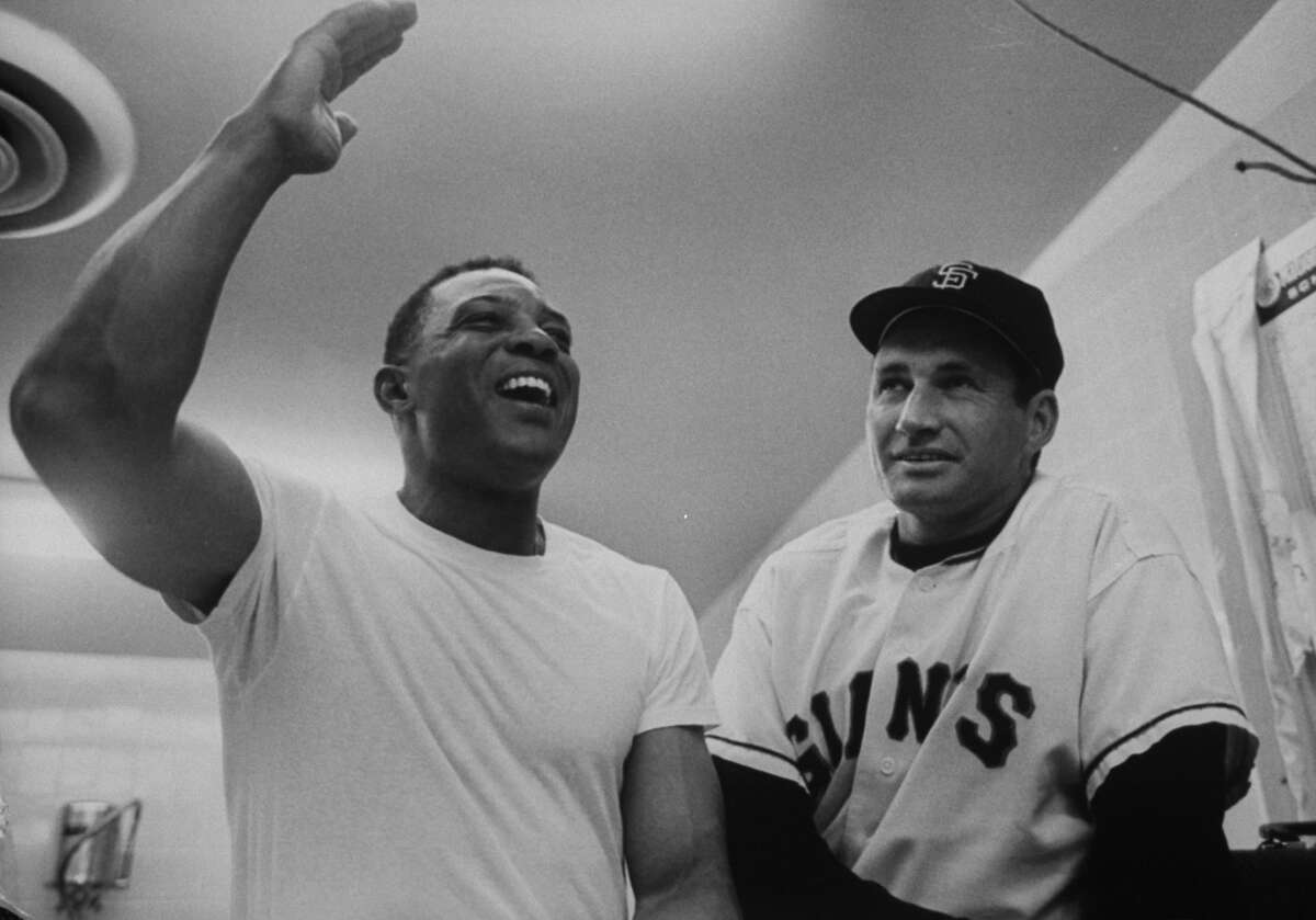 Willie Mays, left, and Giants manager Alvin Dark, right, filming for aNBC documentary, 1963.
