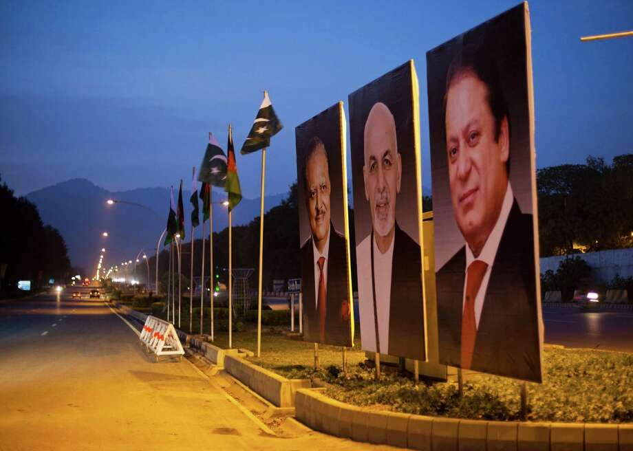 Billboards show photographs of Pakistani Prime Minister Nawaz Sharif, from right, Afghan President Ashraf Ghani and Pakistani President Mamnoon Hussain ahead of Ghani's visit, as displayed on the median of a street in Islamabad, Pakistan. Photo: B.K. Bangash / Associated Press / AP