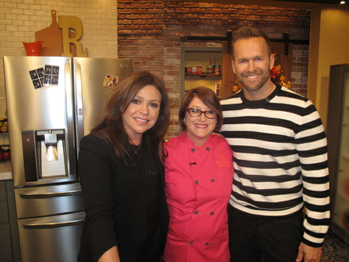 """Joan Cheever, founder of the nonprofit food truck Chow Train (center), with culinary celebrity Rachael Ray and Bob Harper of """"The Biggest Loser."""""""