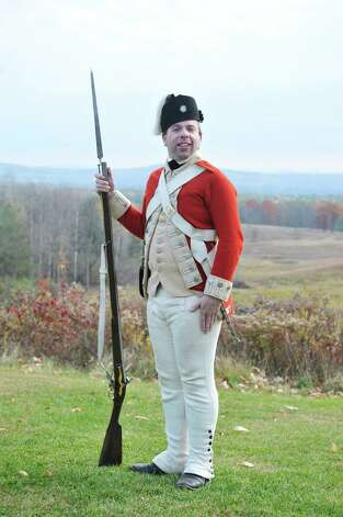 Reinactor Eric Schnitzer, dressed as a private soldier in the British 62nd Regiment in 1777, poses for a photograph at the Saratoga National Historical Park on Monday, Nov. 10, 2014, in Stillwater, N.Y.  (Paul Buckowski / Times Union) Photo: Paul Buckowski / 00029263A