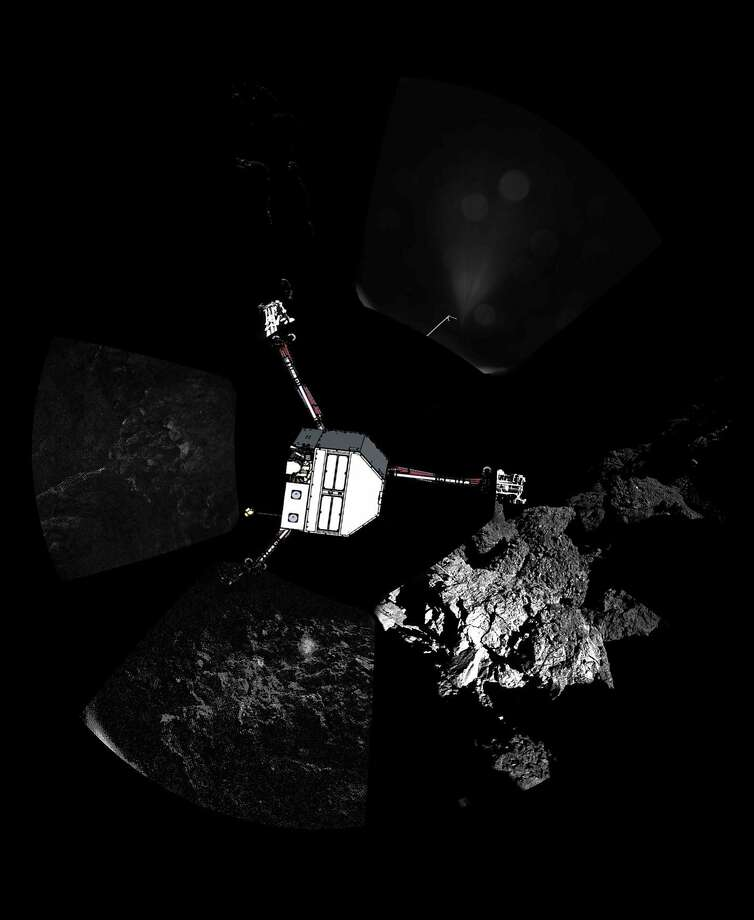"A handout photo released on November 13, 2014 by the European Space Agency, and captured on November 12 by the CIVA-P imaging system, shows a 360º view of the surface of comet 67P/Churyumov-Gerasimenko around the point of final touchdown, during Philae's descent. Superimposed on top of the image is a sketch of the Philae lander in the configuration the lander team currently believe it is in. This images was taken around the time of landing on November 12, when Rosetta was about 18 km from the centre of Comet 67P/Churyumov-Gerasimenko (about 16 km from the surface). Europe's Rosetta spacecraft made contact with its robot craft Philae soon after the lander embarked on November 12 on a solo, seven-hour descent to a comet, ground controllers said. ""Rosetta is receiving a signal from Philae,"" mission operations department head Paolo Ferri said at the European Space Agency (ESA) control centre in Darmstadt, Germany. Communications were re-established on schedule more than two hours after Philae set off at 0835 GMT for a 20-kilometre (12-mile) descent from the Rosetta orbiter, its home for the last decade. AFP PHOTO / ESA/Rosetta/Philae/CIVA  = RESTRICTED TO EDITORIAL USE - MANDATORY CREDIT ""AFP PHOTO / ESA/Rosetta/Philae/CIVA"" - NO MARKETING NO ADVERTISING CAMPAIGNS - DISTRIBUTED AS A SERVICE TO CLIENTS =-/AFP/Getty Images Photo: -, AFP/Getty Images"