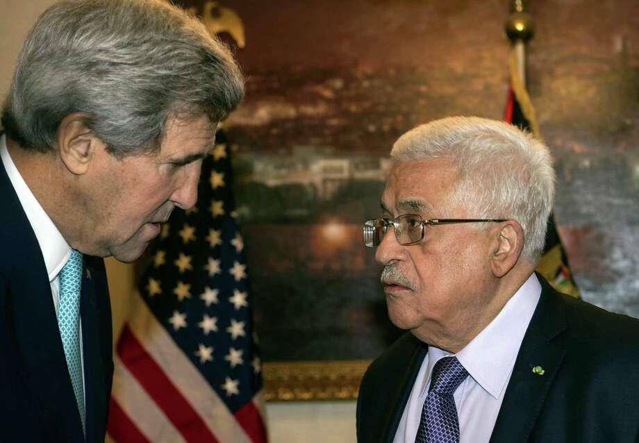 Secretary of State John Kerry, left, speaks with Palestinian President Mahmoud Abbas in Amman, Jordan. Photo: Nicholas Kamm / Associated Press / AFP Pool
