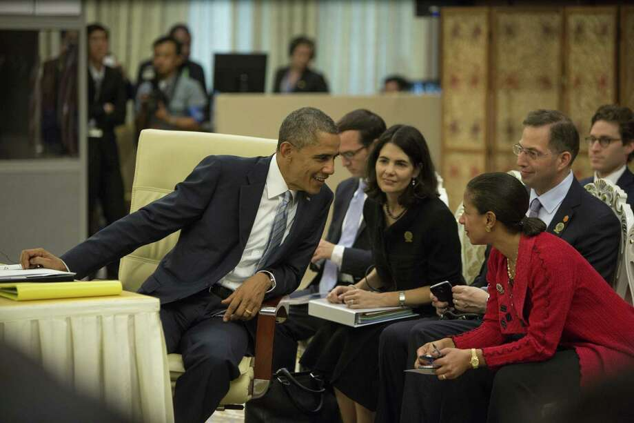 President Barack shares conversation before the ASEAN - US summit begins on the second day of the ASEAN summit in Naypyidaw, Burma. Photo: Paula Bronstein / Getty Images / 2014 Getty Images